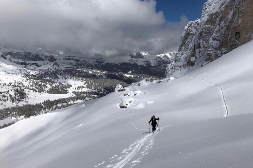 A woman skiing off piste in the Dolomites