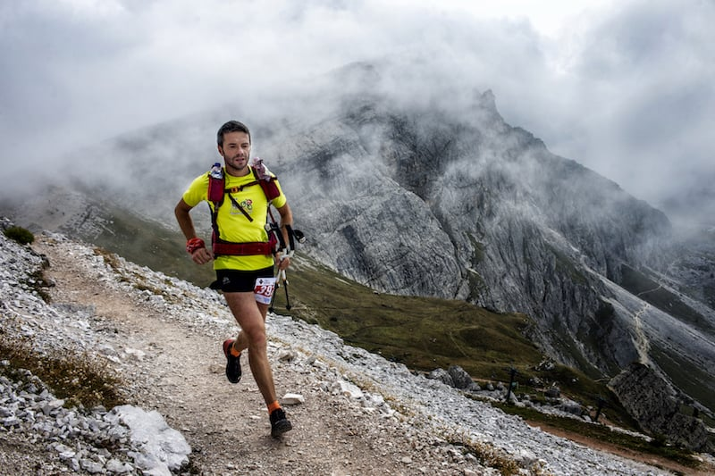 A runner on a trail in the Dolomites